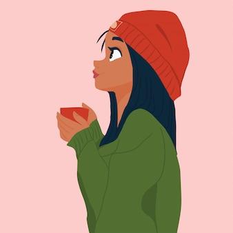 Mädchen im hut und in der strickjacke mit tasse tee