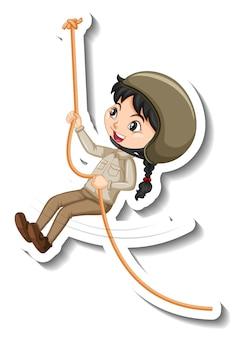 Mädchen im safari-outfit, das an einem seil-cartoon-charakter-aufkleber hängt Kostenlosen Vektoren
