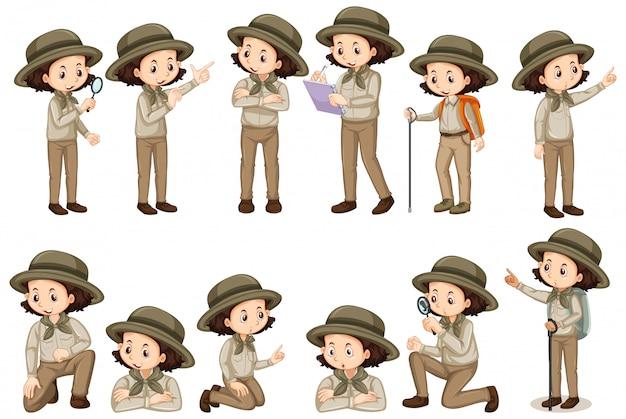 Mädchen im safari-outfit, das verschiedene posen tut