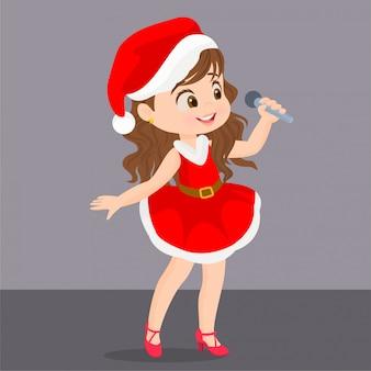 Mädchen im weihnachtskleid, das mit mikrofon singt