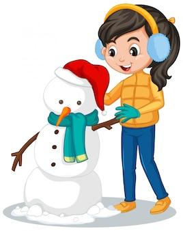 Mädchen in der winterkleidung, die schneemann macht
