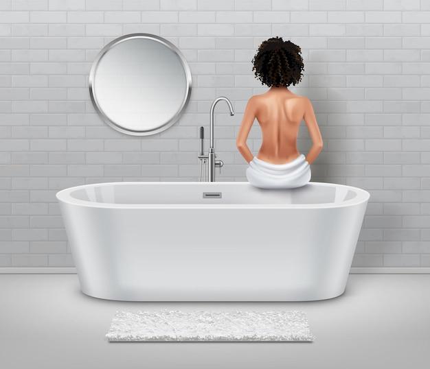 Mädchen in einem weißen badezimmer. spa- und massagekonzept.