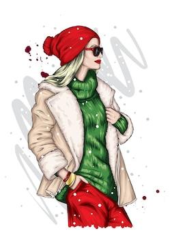 Mädchen in einer weihnachtsmütze und einem mantel.