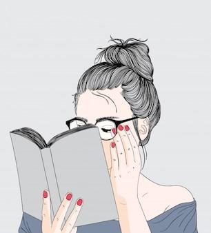 Mädchen liest ein ferienbuch