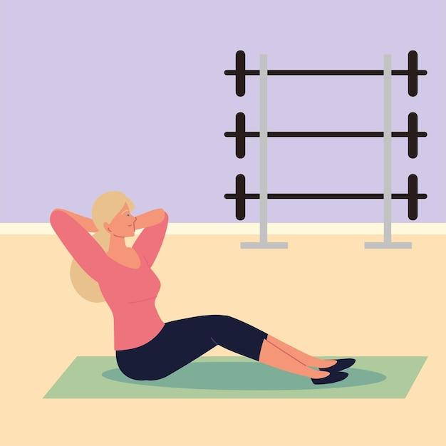 Mädchen macht sit-ups im fitnessstudio