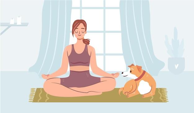 Mädchen macht yoga mit einem hund auf einer matte glückliche frau, die in einem gemütlichen zuhause meditiert lustiger hund in einem halsband