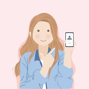Mädchen mit dem langen braunen haar, das fröhlich ihr telefon vorführt