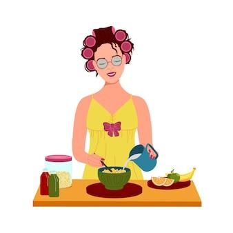Mädchen mit lockenwicklern auf dem kopf macht frühstück
