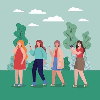 Mädchen mit smartphones im park