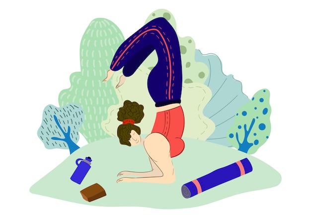 Mädchen praktiziert yoga im park