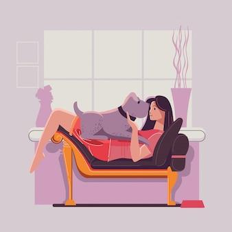 Mädchen und großer netter hund auf sofa