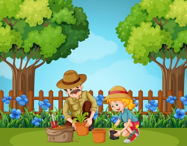 Mädchen und großvater, die im garten pflanzen