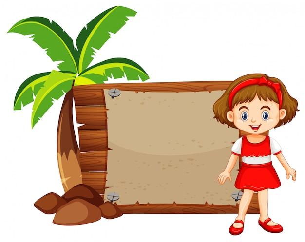 Mädchen und holzschild durch den kokosnussbaum