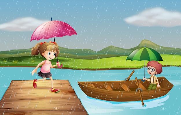 Mädchen und junge im regen am park
