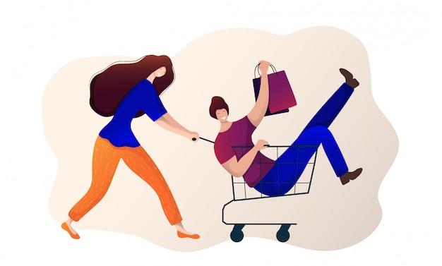 Mädchen und kerl beim einkaufen. frau mit einkaufswagen