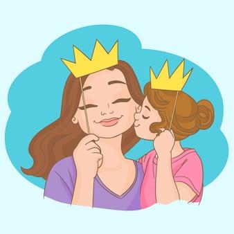 Mädchen und mutter mit kronen auf stöcken
