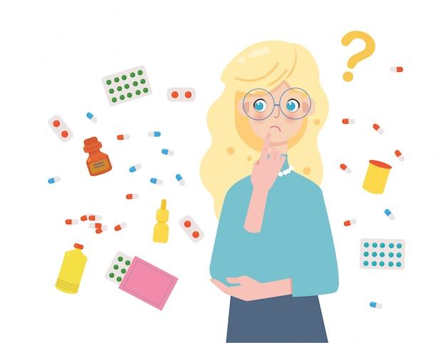 Mädchen weiß nicht, welche medikamente besser zu wählen sind, was helfen wird. große auswahl an medikamenten und vitaminen.
