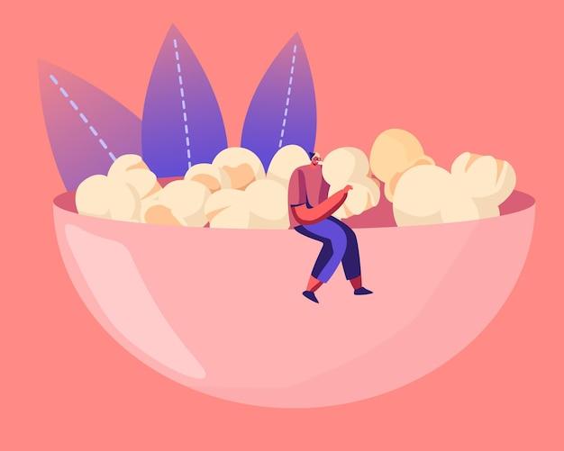 Männliche figur in hipster-kleidung, die auf einer riesigen schüssel voller popcorn sitzt und snacks isst. karikatur flache illustration