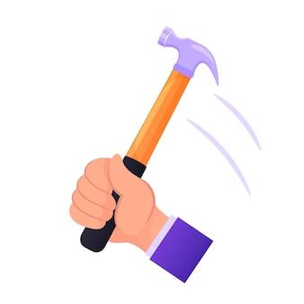 Männliche hand hält hammer, der nagel schlägt