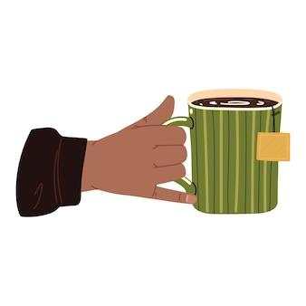 Männliche hand mit teetasse