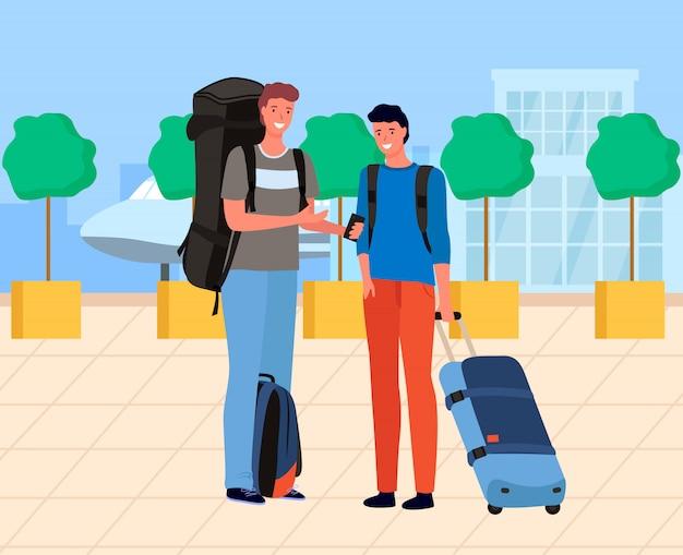 Männliche touristen, die nahe flughafen mit gepäck warten