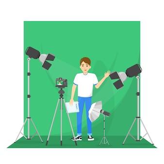 Männlicher blogger, der video für das blog schießt.