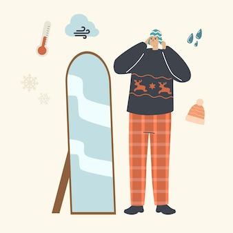 Männlicher charakter in modischer kleidung wählen sie strickmützen, die vor dem spiegel stehen, um im freien spazieren zu gehen