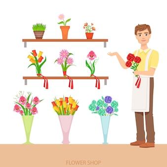 Männlicher florist im blumenladen, der das sortiment demonstriert