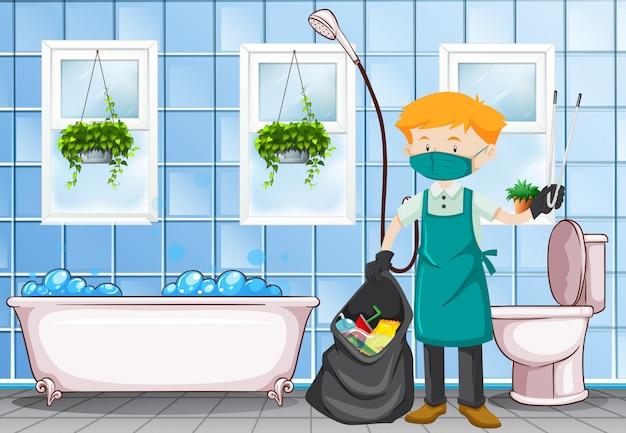 Männlicher hausmeister, der die toilette säubert