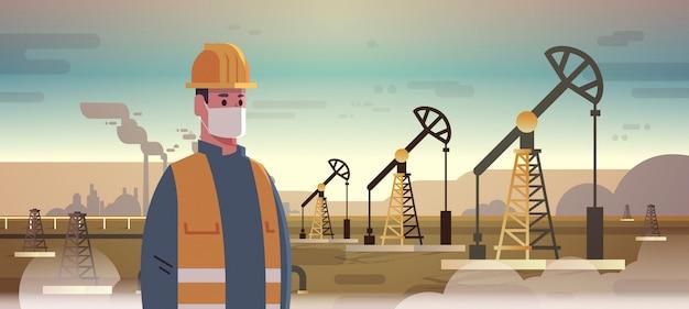 Männlicher ingenieur raffineriearbeiter in maske