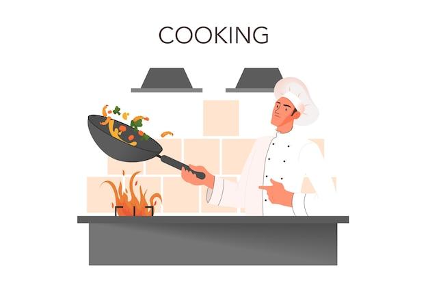 Männlicher restaurantkoch in der weißen einheitlichen kochmahlzeit auf der küche. chef, der eine pfanne hält. leckeres essen für den gast. koch am herd.