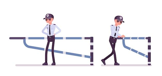 Männlicher sicherheitsbeamter an der mechanischen barriere