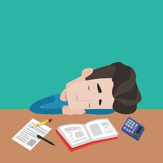 Männlicher student, der am schreibtisch mit buch schläft.