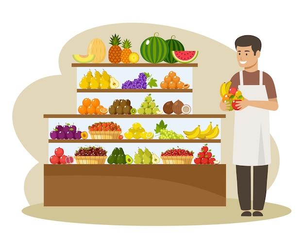 Männlicher verkäufer bietet früchte an