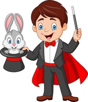 Magier, der ein kaninchen von seinem zylinder herauszieht