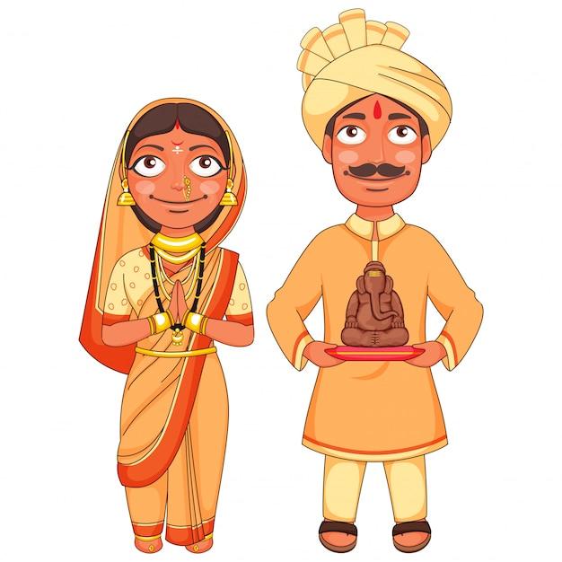 Maharashtrian paar im traditionellen kleid, das eine kleine statue von lord ganesha hält.
