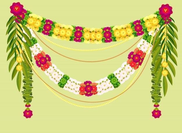 Mala traditionelle indische dekorationsgirlande aus blumen und mangoblättern