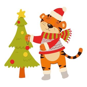 Malbuch mit einem beispiel für kinder, wo ein tiger einen weihnachtsbaum schmückt. amur-tiger in einem roten hut und schal.