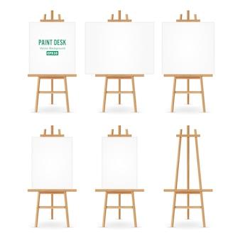 Malen sie schreibtisch-vektor. künstler-staffelei mit weißem papier. isoliert auf weißem hintergrund. realistische maler-schreibtisch-leere leinwand auf staffelei.