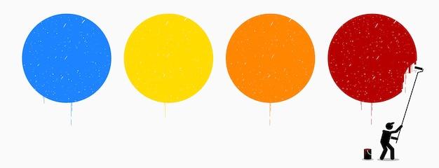 Maler malt vier leere kreise an der wand mit verschiedenen farben von blau, gelb, orange und rot. diese leeren farbigen kreise können mit beliebigen symbolen oder grafiken gefüllt werden.