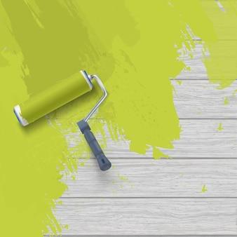 Malerei holzwand mit walzenpinsel und grüner farbe