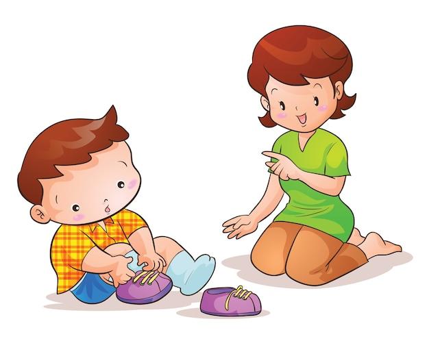 Mama unterrichtet süßen sohn mit schuhen