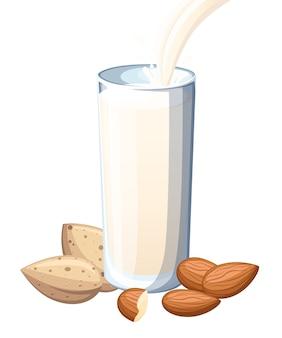 Mandelmilch, die in trinkglas gießt