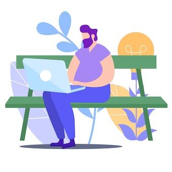 Mann-arbeit mit laptop auf bank im park