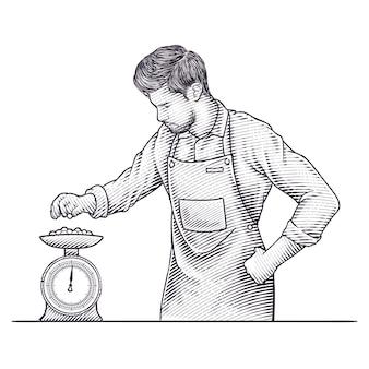 Mann arbeitet mit waage