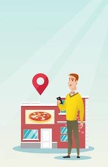 Mann auf der suche nach einem restaurant in seinem smartphone.