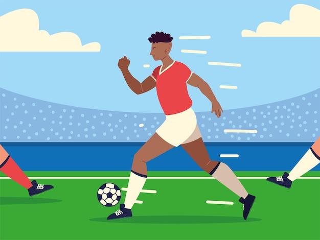 Mann beim spielen des stadionfeldfußballs