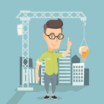 Mann, der auf die ideenbirne hängt am kran zeigt.
