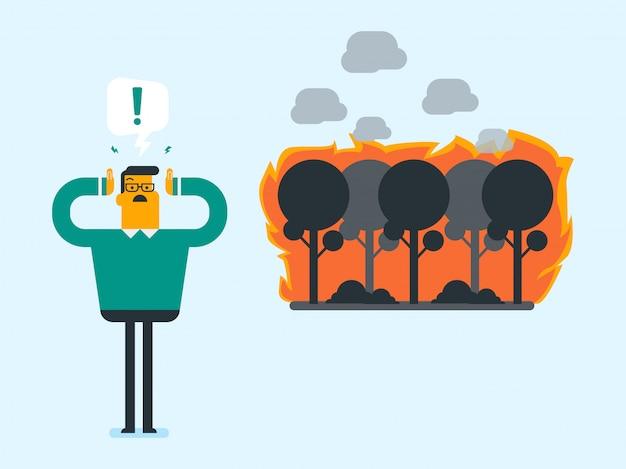 Mann, der auf hintergrund des waldes im feuer steht.