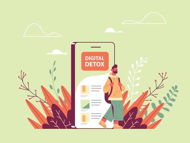 Mann, der aus dem digitalen entgiftungskonzept des mobiltelefons herauskommt, das der digitalen sucht entkommt